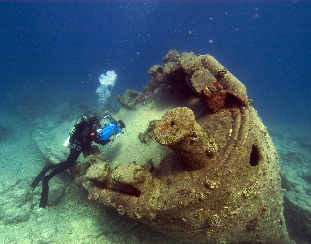 NOAA diver John Brooks inspects the remains of the USS Macaw in Hawaii. (Photo: Robert Schwemmer, CINMS, NOAA). Not the Caribbean, but you get the idea.